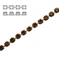 Catena strass, con cristalli non swarovski, base in metallo colore ottone, colore strass SMOKED TOPAZ