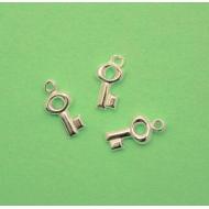 Ciondolo a forma di chiave piccola, 6x13 mm., in Argento 925