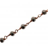 Catena a rosario, con rondelle sfaccettate in cristallo ematite 2,5x3,5 mm., base in metallo colore rosato