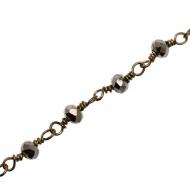 Catena a rosario, con rondelle sfaccettate in cristallo ematite 2,5x3,5 mm., base in metallo colore oro anticato